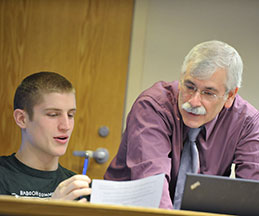 Photo of a student and teacher. Link to Gifts of Cash, Checks, and Credit Cards.