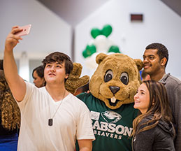 Photo of students and Babson mascot. Link to Closely Held Business Stock.